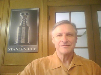 Phil Myre with Stanley Cup background