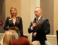 Mack and Ria speaking at a corporate breakfast event