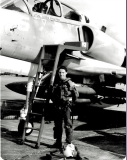 Linda Shaffer-Vanaria shown as a Lieutenant in front of the A-4 aircraft she piloted at Roosevelt Roads, Puerto Rico