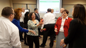 Team Building Workshop Participants engaged and having fun together in group challenges.